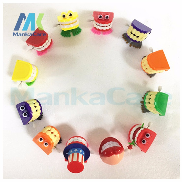 1 Piece Toys wholesale spring Creative Dental Gift Dental Funny Wind up Bouncing font b Teeth