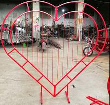 лучшая цена Wedding truss arch love arch peach heart iron work frame heart shaped door frame special-shaped frame heart shaped arch