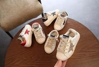 Autumn and winter new Korean men and women baby white shoes leather girls casual five pointed star pattern plus velvet children'