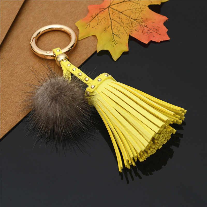 Venda quente couro do plutônio borlas chaveiros com bola de pele pom pom pom chaveiro para as mulheres saco pingente de carro chaveiros jóias titular chave