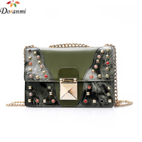 DORANMI Hip Hop Style Flap Messenger Bag 2017 New Brand Design Rivet Decorated Hard Handbag Women