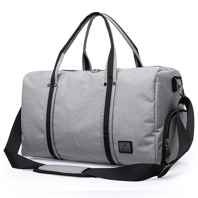 bd9287e81d31 Hot!! New Arrive Brand Men Travel Bag Tote Shoulder Portable Handbags Large  Capacity Weekend Bag Women Waterproof Duffle Bag B33