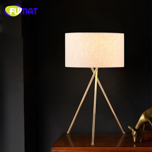 Nordic creative gold tripod table lamp study bedroom bedside light nordic creative gold tripod table lamp study bedroom bedside light american modern hotel fabric lampshade desk aloadofball Image collections