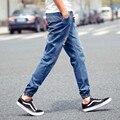 2015 Chegada Nova mens Elegante motociclista jeans rasgado calças de Brim Basculador Magras Calças Jeans Plus Size Calças XXXL 4XL 5XL