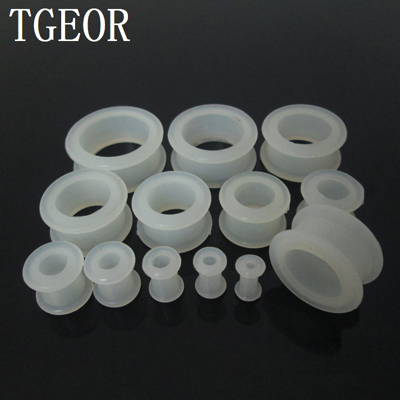 Hot Selling 12pcs mixed 12 gauges round shape silicone glow in the dark clear white flexible hollow ear tunnels free shipping