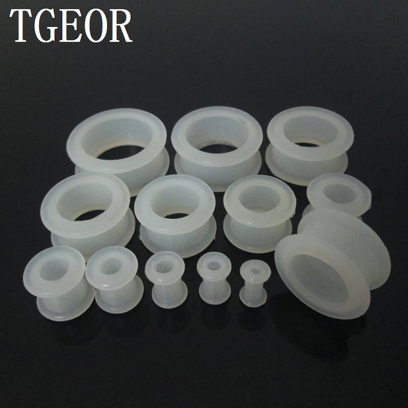 Jual panas 12 pcs dicampur 12 pengukur bentuk bulat silikon bersinar dalam gelap jelas putih fleksibel lubang berongga telinga pengiriman gratis