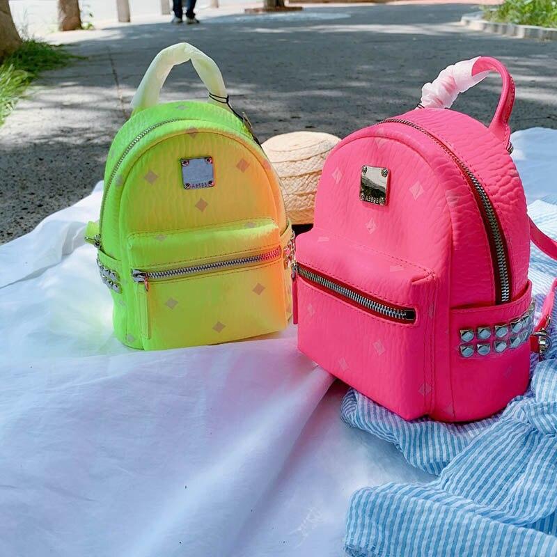 2019 luxe célèbre marque rivet en cuir designer sac à dos sacs pour ordinateur portable bandoulière sacs à main femmes graffiti couleur fluorescente