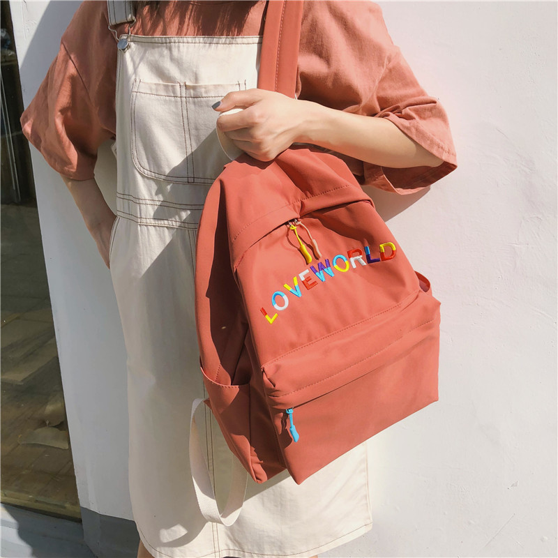 DCIMOR New Waterproof nylon Women Backpack Coloured English Embroidery Travel Bag Women Preppy School Bags For Teenagers Mochila