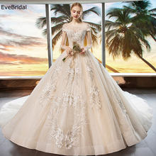 Роскошное свадебное платье в сеточку с круглым вырезом рукавами