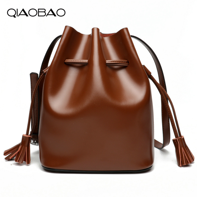 QIAOBAO drawstring bucket bag women genuine leather handbag female shoulder crossbody bag with tassel ladies brand tote bag 2016 women fashion brand leather bag female drawstring bucket shoulder crossbody handbag lady messenger bags clutch dollar price