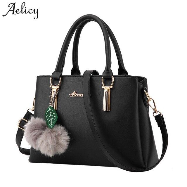 7a060ca07f Aelicy Luxo PU Couro Falso Designer Bolsa Com Hairball Nova Top Hot Vender Moda  Saco Da