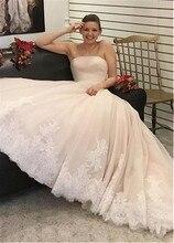 רומנטי טול סטרפלס מחשוף אונליין חתונת שמלה עם תחרת אפליקציות ואגלי אבנט ארוך כלה שמלות
