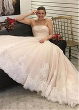 Romantic Tulle Strapless Neckline A line Wedding Dress With Lace Appliques Beading Sash Long Bridal Gowns