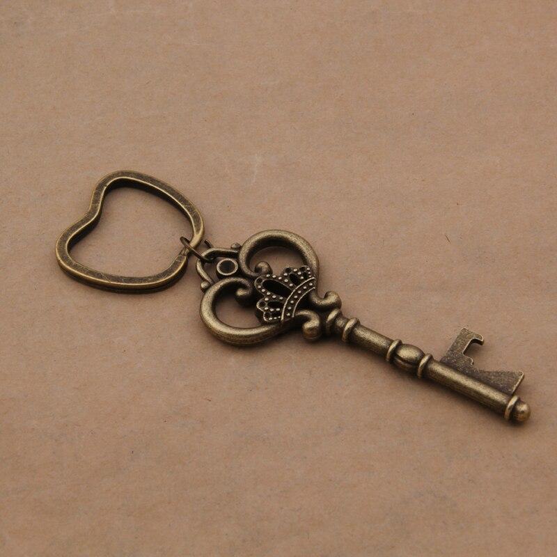 Yage 50 pcs/lote classique Creative faveurs de mariage parti cadeaux Antique Bronze Skeleton Key bouteille de bière ouvre avec anneau de pomme