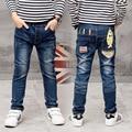 Año nuevo, de hildren ropa de otoño pantalones de los niños pantalones del bebé Delgado Personalidad pantalones vaqueros Chicos, muchachos pantalones vaqueros rasgados