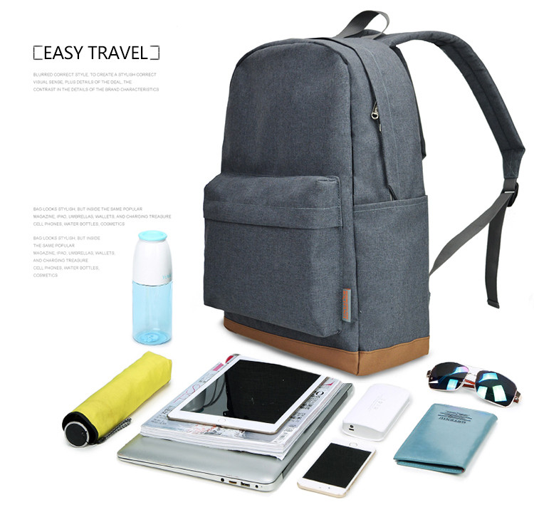 a backpack in grey with a laptop and books