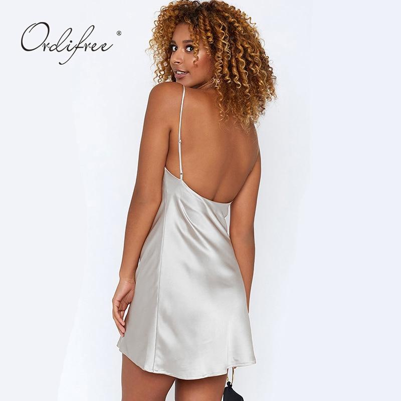 138c3ceafe3 Ordifree 2019 Summer Women Silk Mini Dress Spaghetti Strap Backless Short  Satin Slip Dress-in Dresses from Women s Clothing on Aliexpress.com