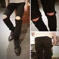Los hombres pantalones vaqueros rasgados flacos de moda blanco negro hip hop jeans pantalones diseñador de la marca delgado distressed vaqueros cremallera kanye west