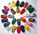 Fábrica al por mayor 100 par/lote verano moda new kids pu de cuero mocasines bebé niñas suela blanda bebe infantil zapatos del niño 0-36 m