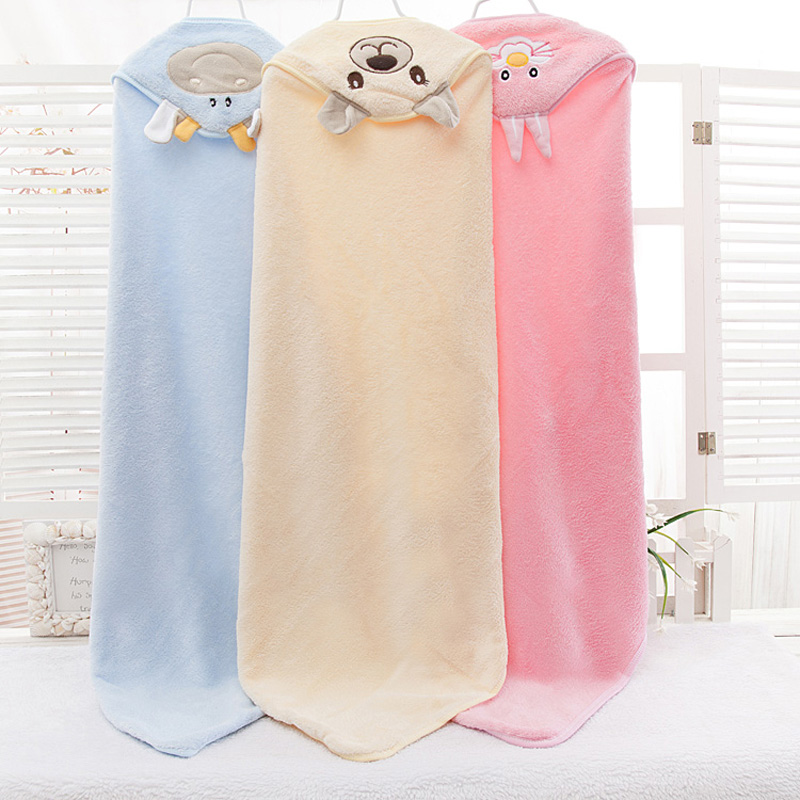 The newborn baby is held by the baby The baby blanket is held by the coral fleece Hooded bath towel Blanket