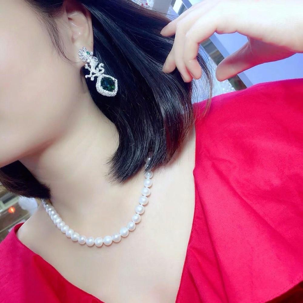 Qi xuan_joaille_nouvelles boucles d'oreilles asymétriques élégantes S925 argent incrusté Zircon élégant et irrégulier irrégulier _ ventes directes d'usine