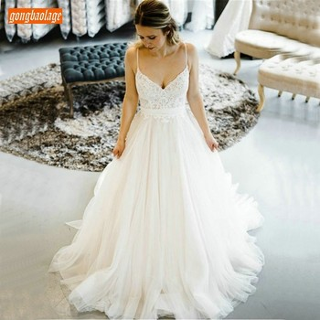 Gorgeous Boho Ivory A Line Wedding Gowns Backless Spaghetti Strap Sexy White Wedding Dresses Lace Tulle Sweep Train Bridal Dress
