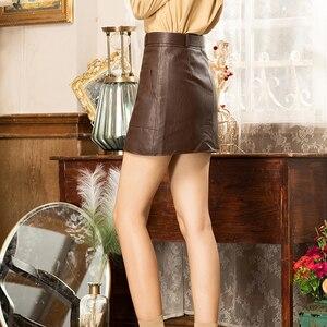 Image 5 - Faldas de cuero sintético de cintura alta para mujer, minifalda de línea a con cinturón, color marrón, negro y blanco, para Otoño e Invierno