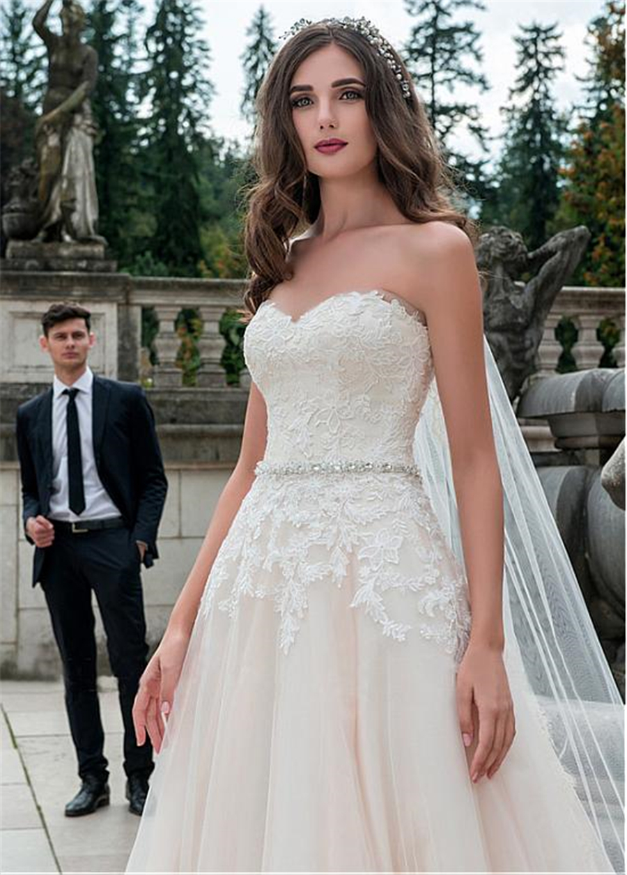 Glamorous Tulle Sweetheart Neckline A-Line Wedding Dress With Lace Appliques Nude Bridal Dress with Beading Sash