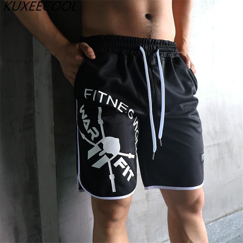 Los nuevos hombres de la moda deportiva playa pantalones cortos Pantalones deportivos pantalones de Fitness corto Jogger de gimnasios de los hombres de gran tamaño pantalones cortos