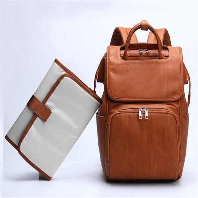 Bolsa de pañales para bebés de cuero PU, mochila para madres, bolsa de pañales de gran capacidad con almohadilla cambiadora + correas para cochecito, color marrón y negro