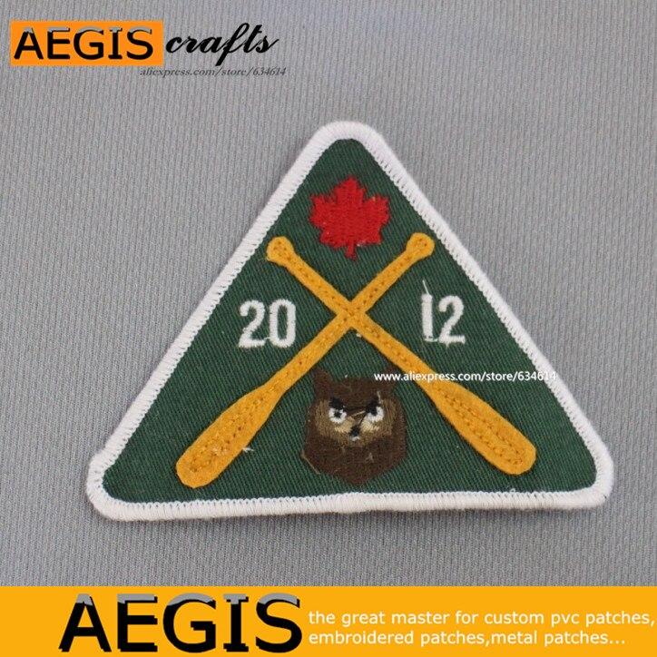 Вышивка логотипов знак