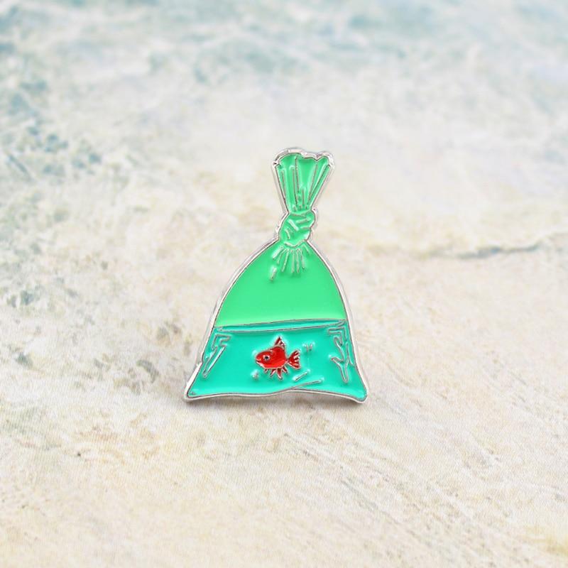 Creative Green Fish Bag Brooch Fishing Net VERAMEAT Goldfish Enamel Pin Denim Sweater Badge Kids Ocean Dream Punk Gifts