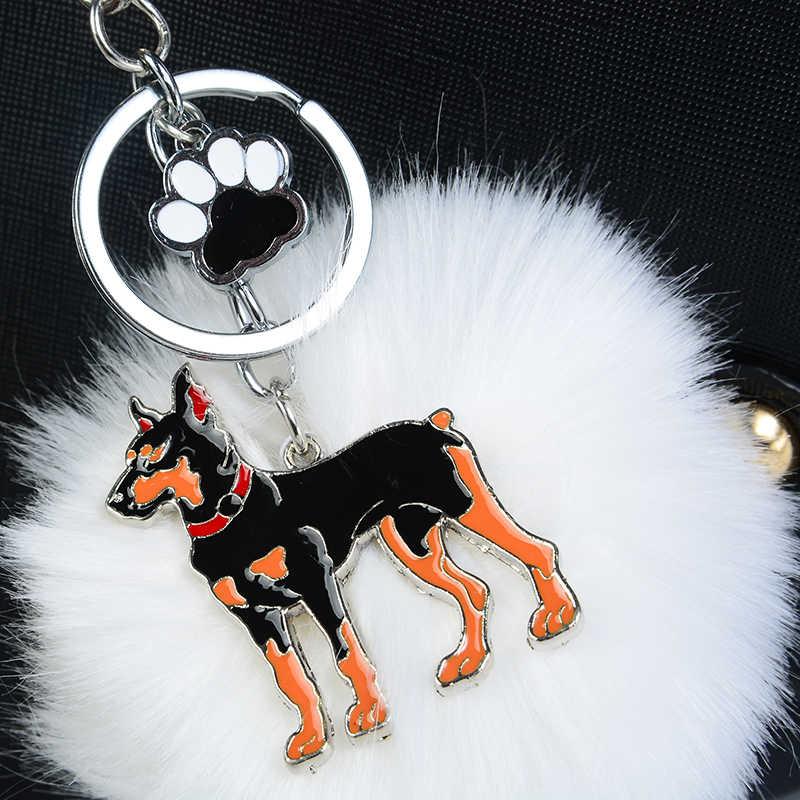 Llaveros de piel de conejo pompón Dobermann para Mujeres Hombres Pom bola perro colgante bolso llavero de coche llave anillo de joyería