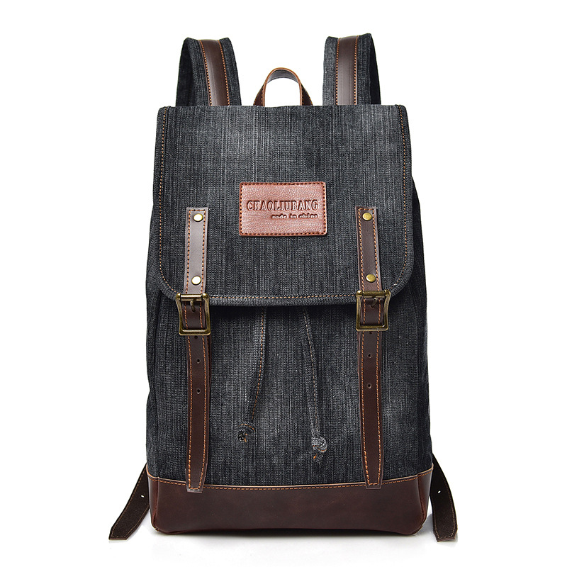 The new style stitching character denim double shoulder bag men and women universal package Korean backpack college wind travel
