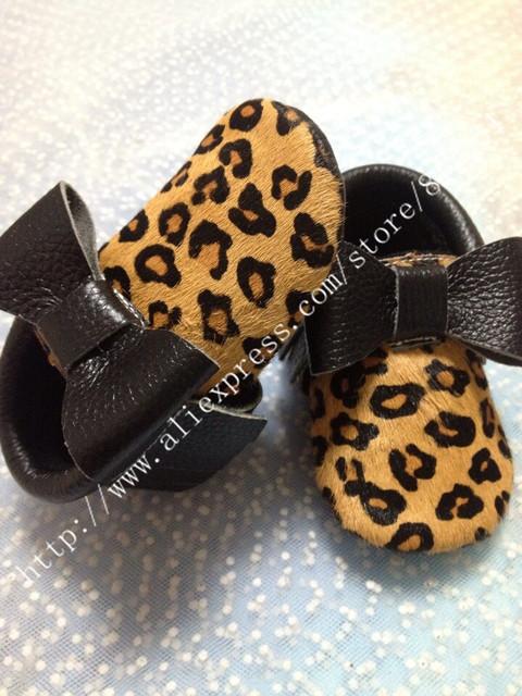 Nueva franja mocasines arco zapatos de cuero genuino de crin leopardo del bebé prewalker niños pequeños/bebés fringe mocasín zapatos de cuero de vaca
