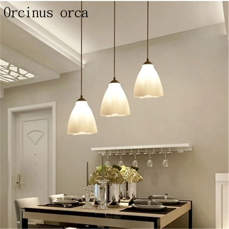 Restaurant chandelier modern minimalist three creative dining table lamp fashion personality dining room LED living room lamps creative dining room three modern minimalist 1 3 heads lamps fashion glass pendant light dining room led lamp lighting