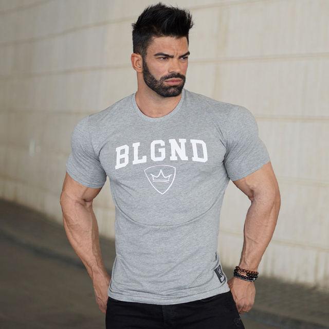 5b394e68c65 Zomer Nieuwe heren Merk katoenen t-shirt Fitness bodybuilding Korte mouw t-shirts  sportscholen