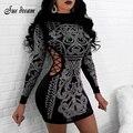 Mujer 2019 última moda de invierno Sexy negro de mujer caliente de perforación de manga larga de cuello alto hueco Mini vestido de vendaje