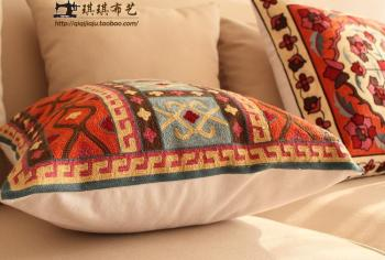 Geometric embroidered cushion cove