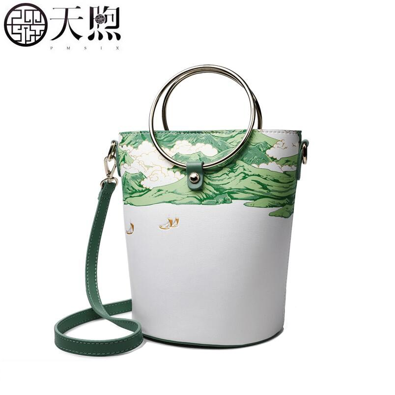 Famous brand top quality Cow Leather women bag  2018 New Printed Leather Handbag National wind slung small bag bucket bagFamous brand top quality Cow Leather women bag  2018 New Printed Leather Handbag National wind slung small bag bucket bag