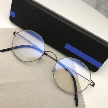 d7e4b6dced De titanio gafas de marco de los hombres sin tornillos de negocios Retro  miopía ronda coreano gafas mujeres óptico receta de diseño de marca