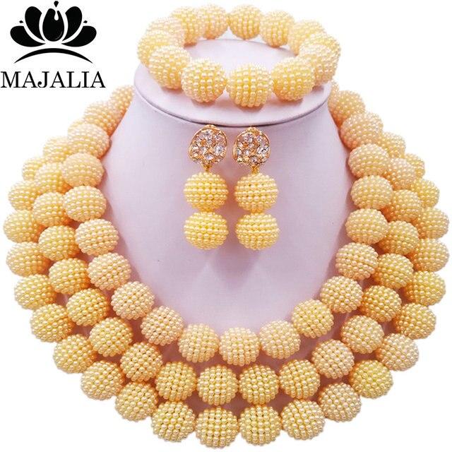 7360406eb96f Conocida majalia moda nigeriana boda Africana perlas joyería conjunto beige plástico  cristal collar de perlas de
