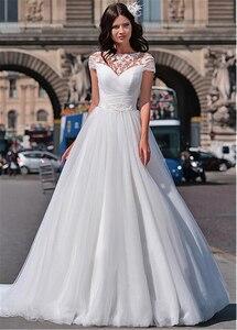 Image 2 - Tuyệt vời Voan Ngọc Viền Cổ Chữ A Váy áo Với Ren Appliques Ngắn Tay Cô Dâu Váy ĐầM Ren