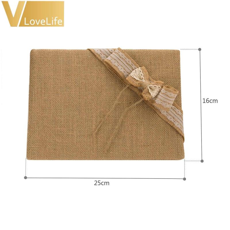 Livre dor Jute avec dentelle et noeud