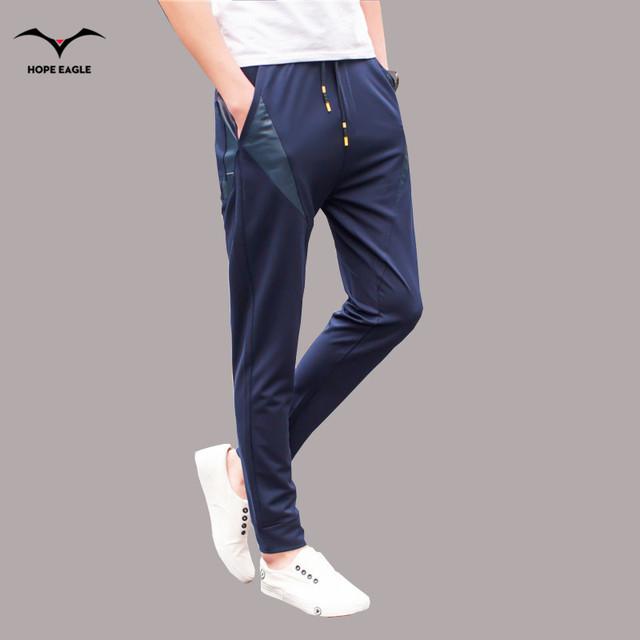 Pantalones de los hombres 2016 de primavera y otoño nuevos hombres de pantalones casuales pies cerca de punto pantalones más código de tamaño M-4XL negro y azul colores