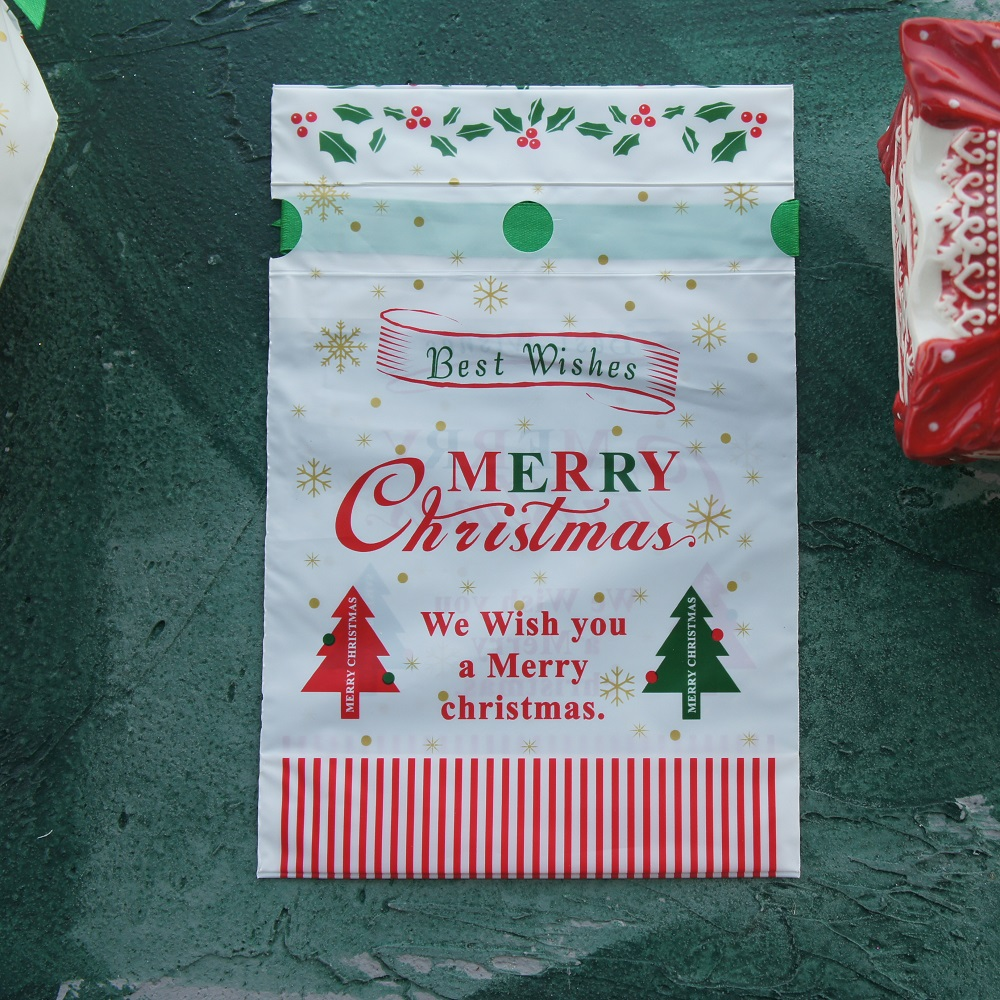 23 5 14 5cm 50pcs merry christmas red green tree design Gift Wrap Storage bag party Decoration Plastic Packaging keep use in Gift Bags Wrapping Supplies from Home Garden