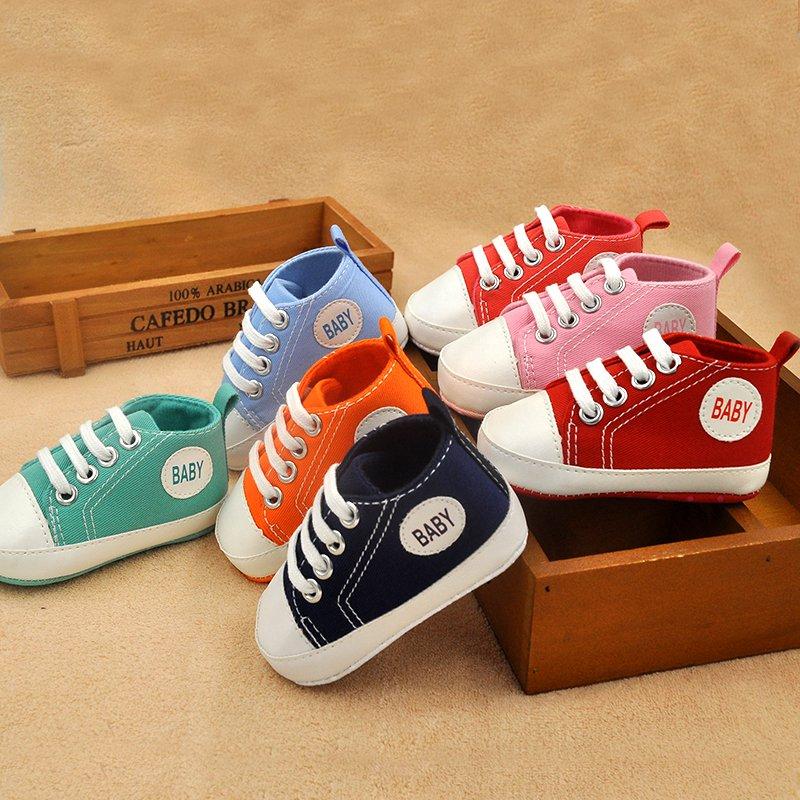 Nouvellement classique toile sport baskets garçons filles premiers marcheurs bébé chaussures infantile enfant en bas âge bébé chaussures semelle souple anti-dérapant