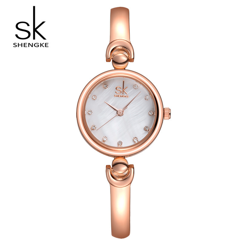 купить SK Brand Fashion Stainless Steel Wrist Watches Luxury Women Gold Silver Dress Watch Quartz Watches Relogio Feminino S0013 по цене 883.29 рублей