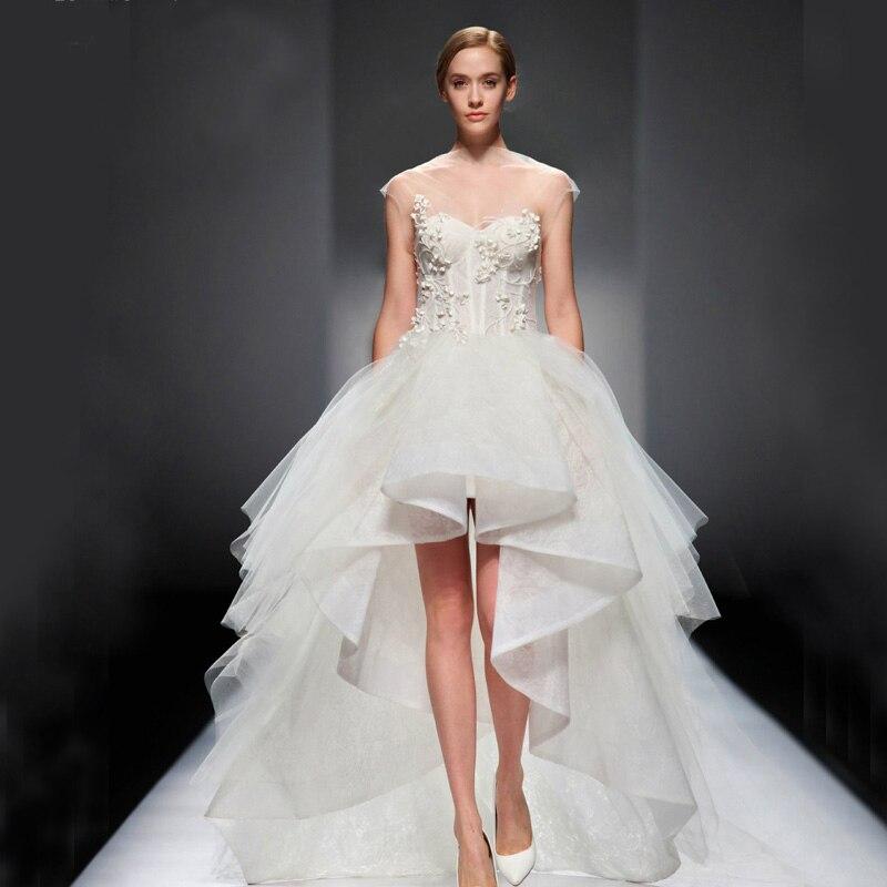 Vestido de novia corto adelante y largo atras