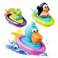 Baño del bebé juguetes para niños nuevo inspire la imaginación animal encantador play tire de cadena de goma de agua pato de juguete barcos